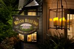 The Welsh Hills Inn - Inn Sign and Bay Window at Night.jpg