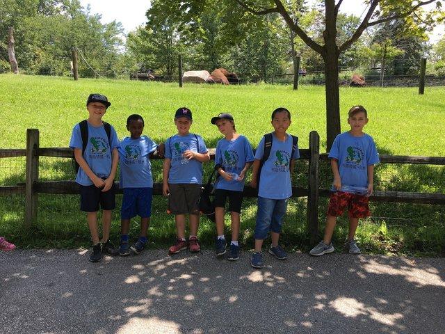 boys by fence shirts.JPG