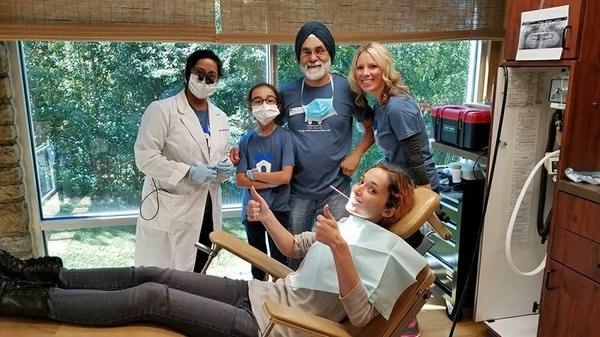 Dr. Bath, his team and a happy patient..jpg