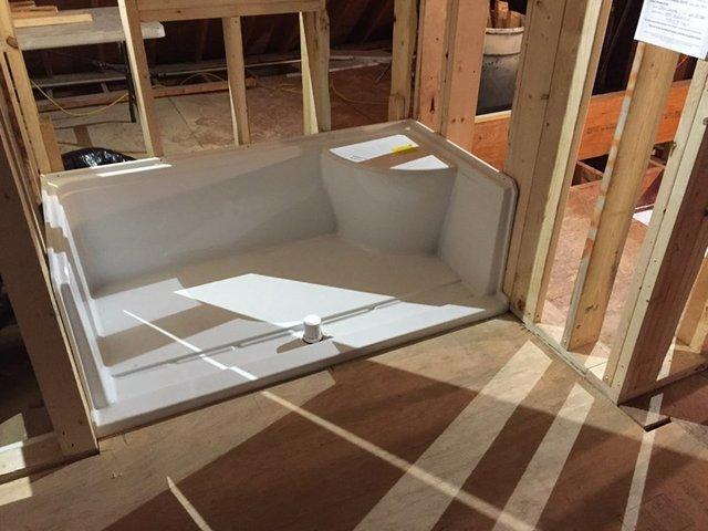 During_framing & new shower base 2nd story bathroom addition.jpg