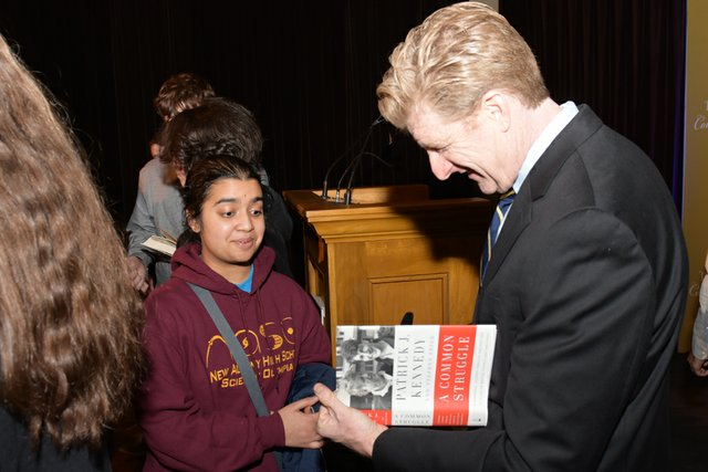 Patrick Kennedy Signing Student's Books_courtesyofLornSpolter.jpg