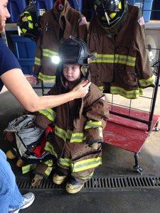 kid in fire gear.jpg