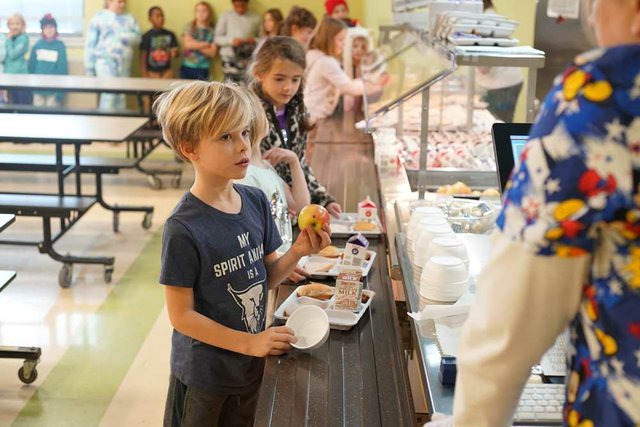 Second grader Miles Beale makes a healthy choice during lunchtime at Stevenson Elementary.  (Photo courtesy of Marc Alter).jpg