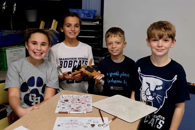 Edison Intermediate fifth graders Madelyn Smith Ejheni Mdivanian Benny McCain and Matt Reichert display their Hands of Gratitude device.jpg