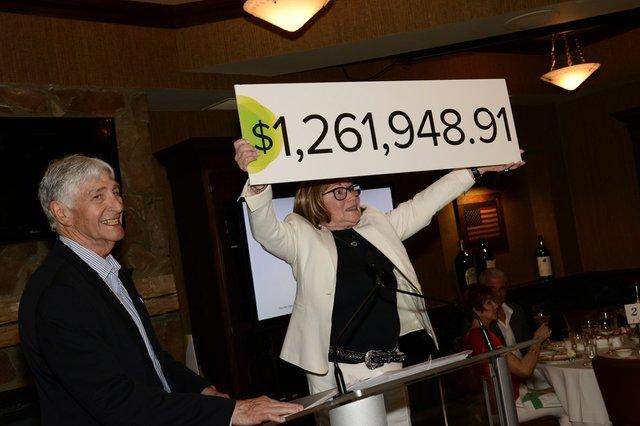 Good lead image - 2019 CFL - Judy&Steve_dollars raised sign.jpeg