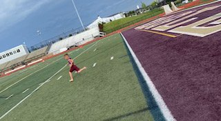 Braxton Baker training on a footbal field.jpg