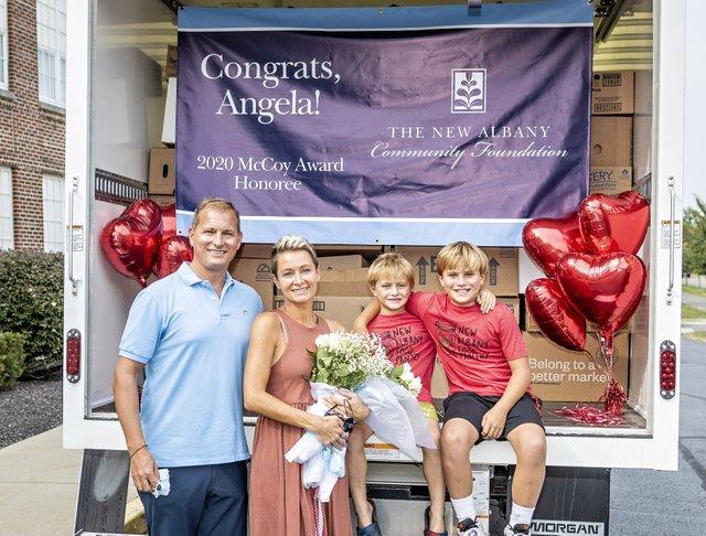 2020 McCoy Award recipient Angela Douglas and family by James DeCamp.jpg