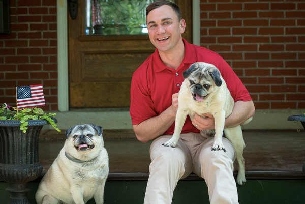 Auditor-Stinziano-bio-at-home-with-dogs-pugs.jpg