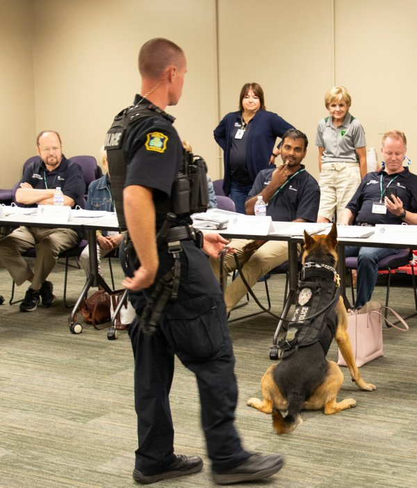 The police K-9, one of the most popular parts of the academy, goes around the room during the drug search session. Photo by John League.jpg