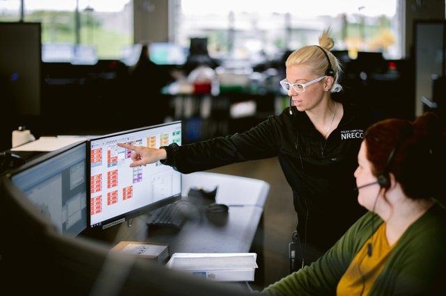 Communications technician Katie Cutrer trains technician Ashley Hayes at NRECC (1).jpg