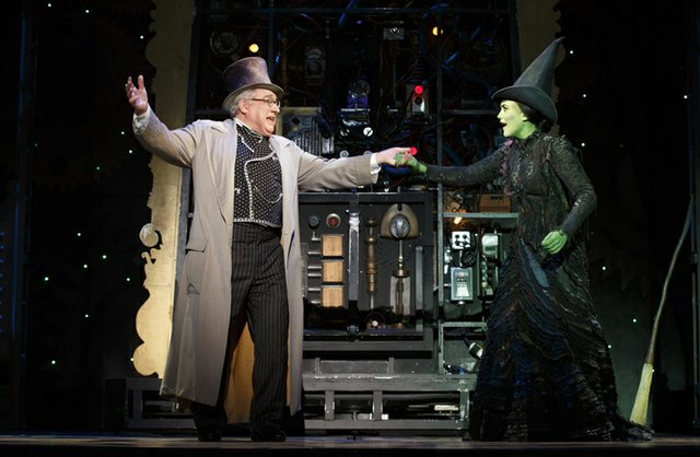 Stuart Zagnit as The Wizard and Emily Koch as Elphaba. Photo by Joan Marcus.jpg