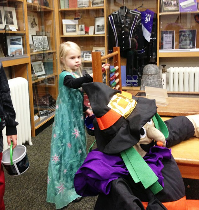Checking out kids touch-and-learn area at Historical Museum.jpg