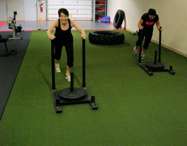Rosalie high res pushing sled.jpg